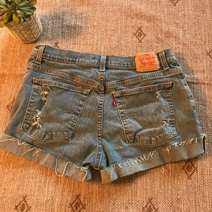 Levi's high rise distressed jean shorts size 12